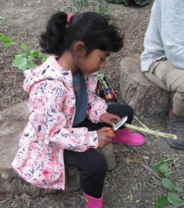 Child learning how to use tools